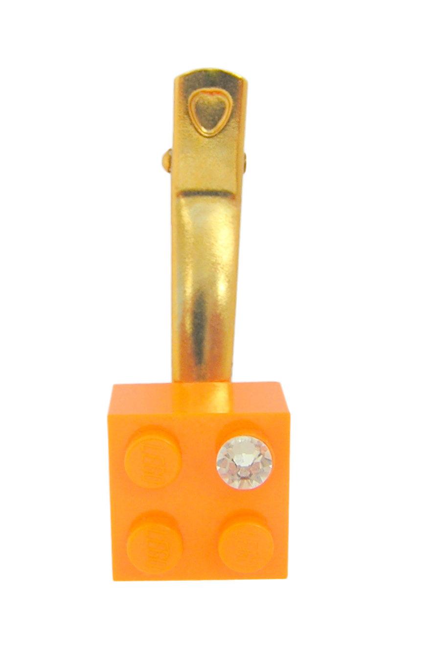 Orange LEGO® brick 2x2 with a 'Diamond' color SWAROVSKI® crystal on a Gold plated hair clip (one piece)