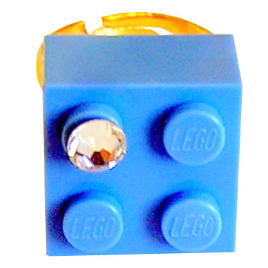 ​Light Blue LEGO® brick 2x2 with a 'Diamond' color SWAROVSKI® crystal on a Gold plated adjustable ring finding