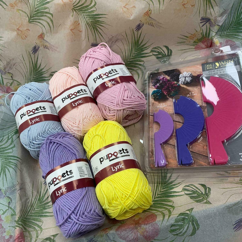 Pompom Art 'Isewlation' craft package including 5 assorted balls of wool and 1 pompom maker.