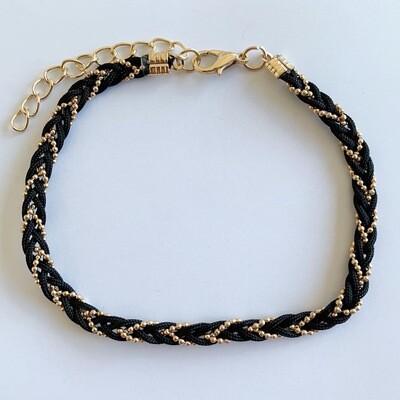 Gevlochten enkelbandje zwart/goud