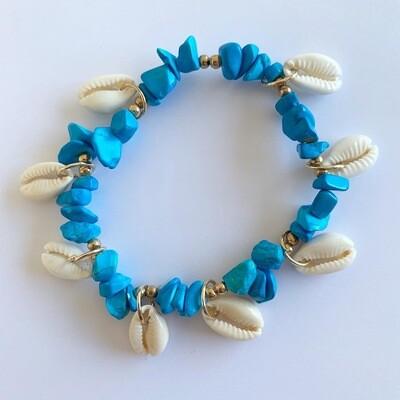 Schelpen enkelbandje met blauwe kraaltjes