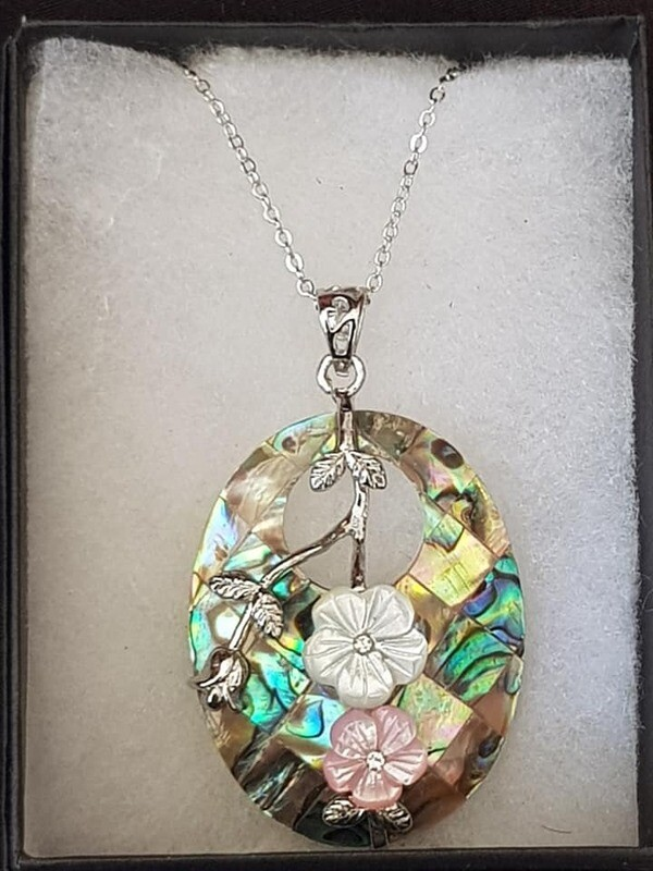 Hand Carved Shell Pendent