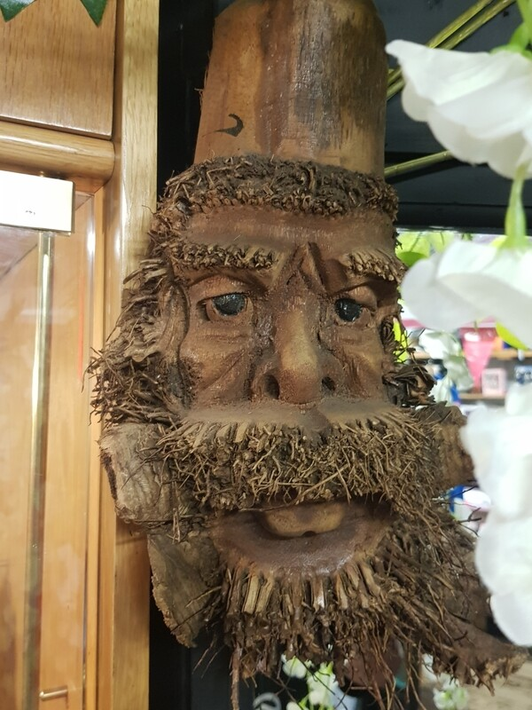 Hand carved tree root man of the forest