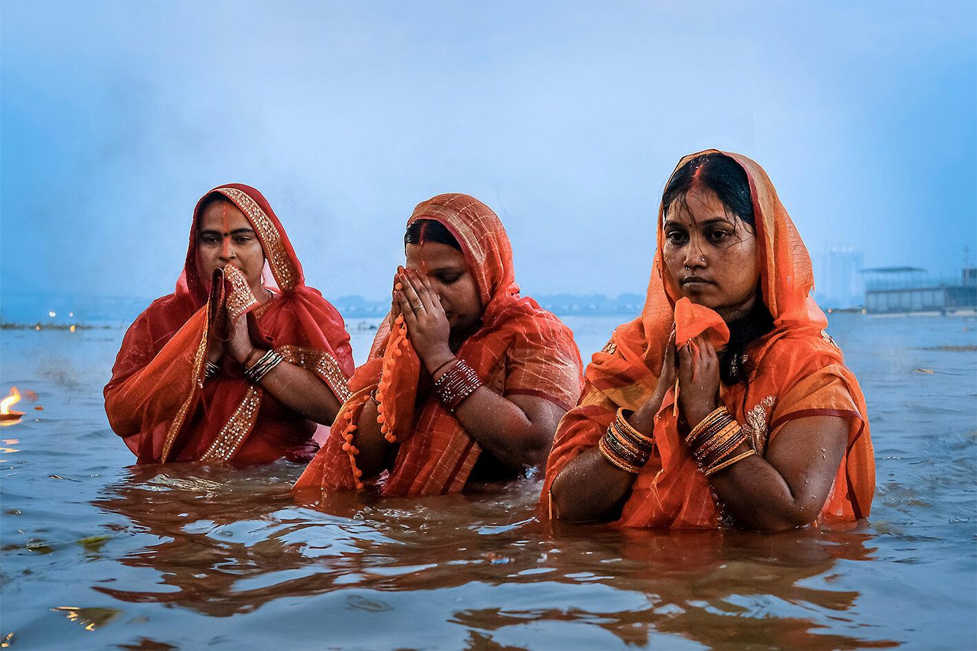 Three devotees in the Ganga