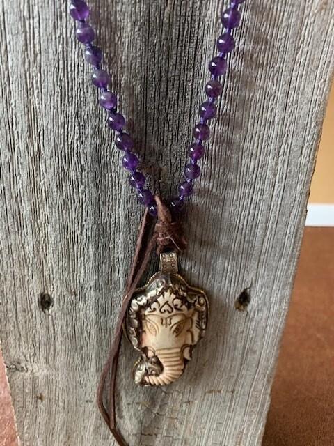 Tibetan Silver And Bone pendant on Amethyst necklace