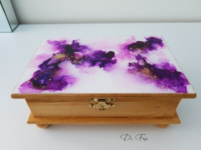 Small wooden jewellery box with decorative kid