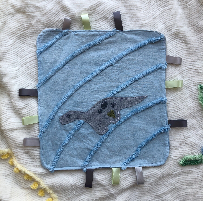 Moxie & Zab - Tag-a-Long Blanket ~ Grey Dinosaur on Blue Chenille