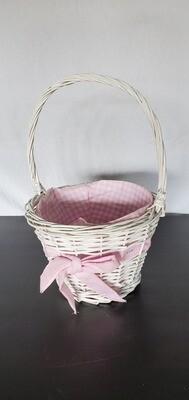 White wicker basket w/ pink bow