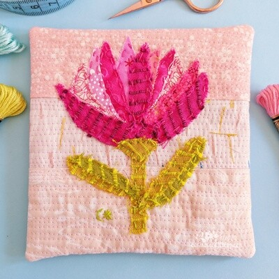 Pink appliqué flower wall hanging