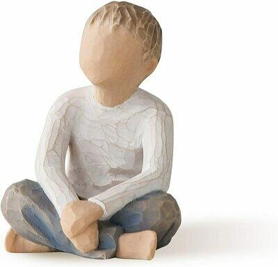 Imaginative Child - Boy Sitting Crossed Legged