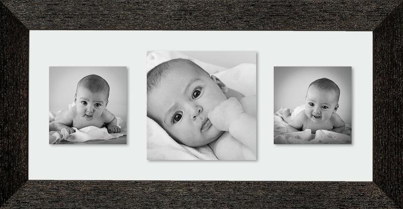 Tre foto su cornice nera