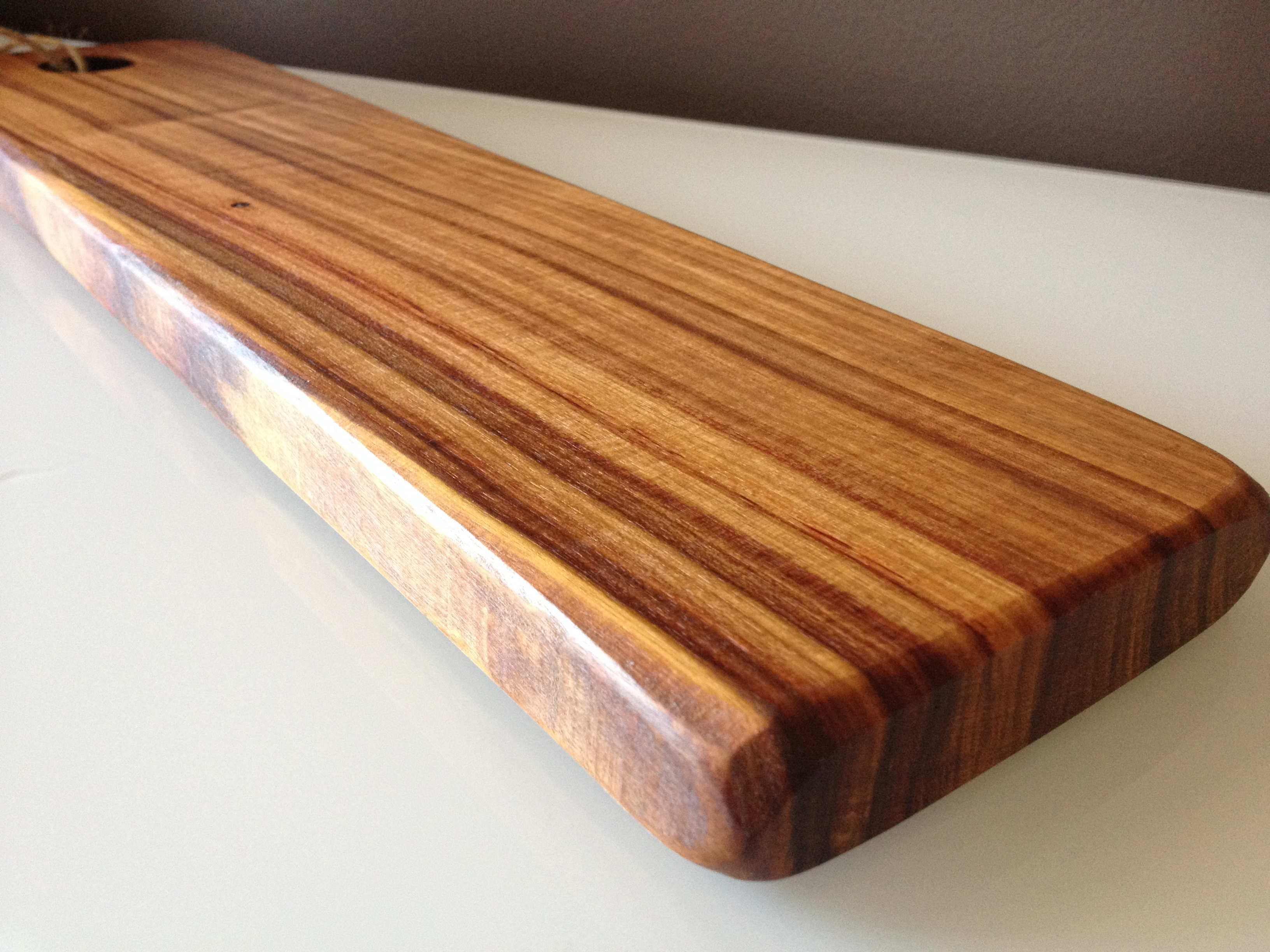 African wood cutting board natural edge