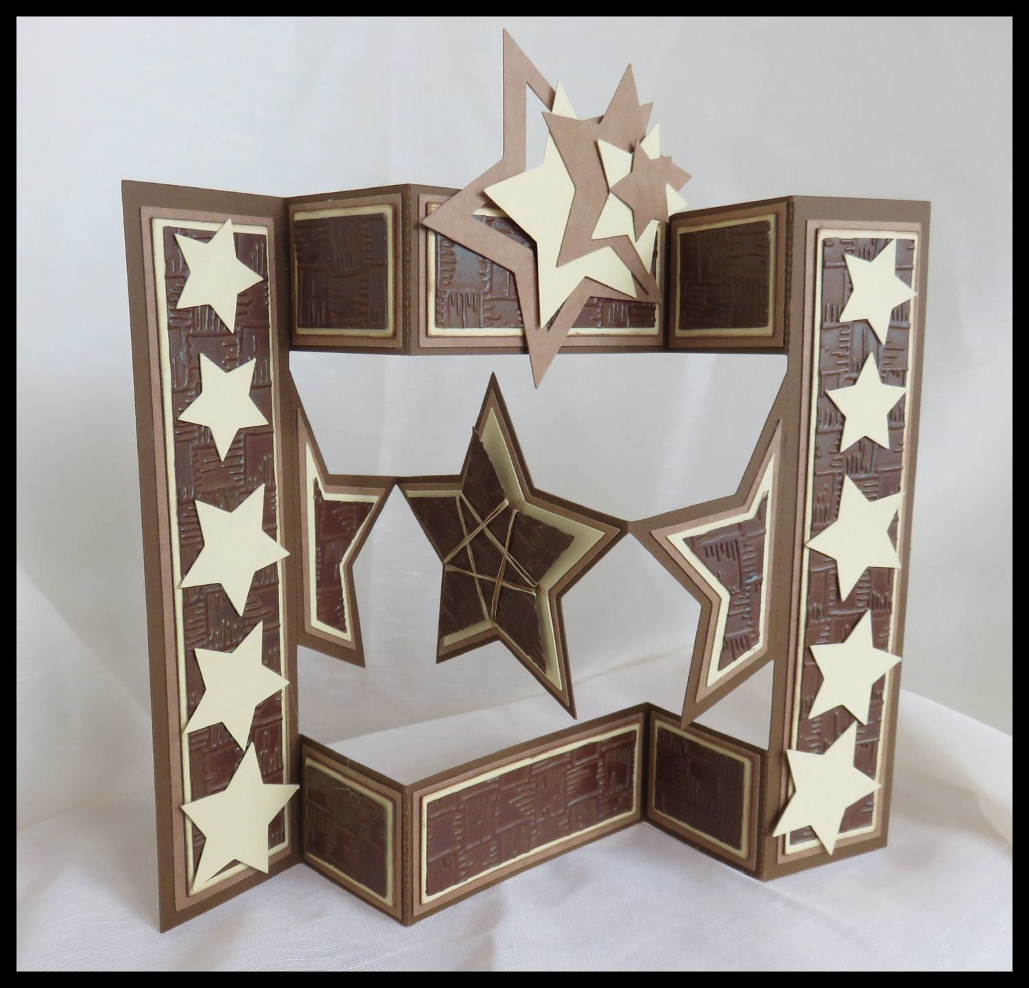 Shutter card tri fold  with star shaped inner panels