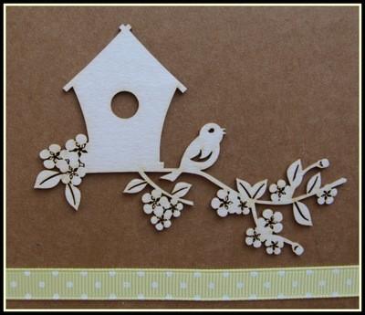 Birdhouse Sitting on Blossom Branch