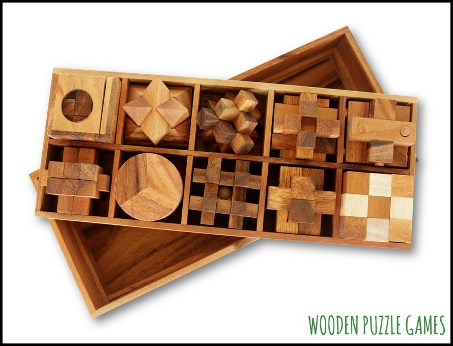 Set of 10 Puzzles in a wooden Box