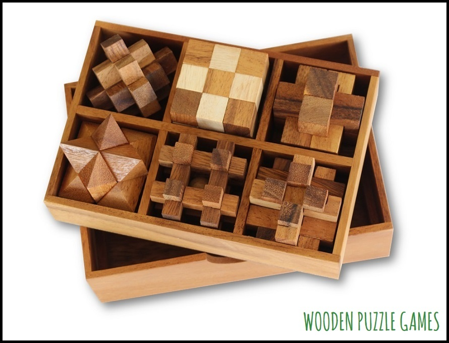 Set of 6 Puzzles in a wooden Box