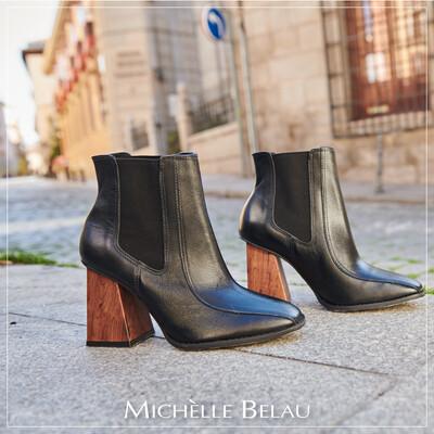 Botines color negro con taco de madera