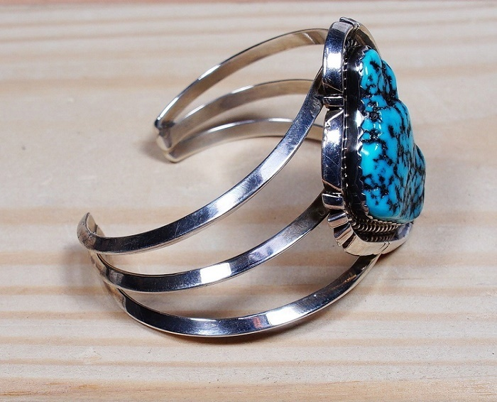 Image of the right side of the baroque cabochon cuff showing the large Sleeping Beauty turquoise stone in the center
