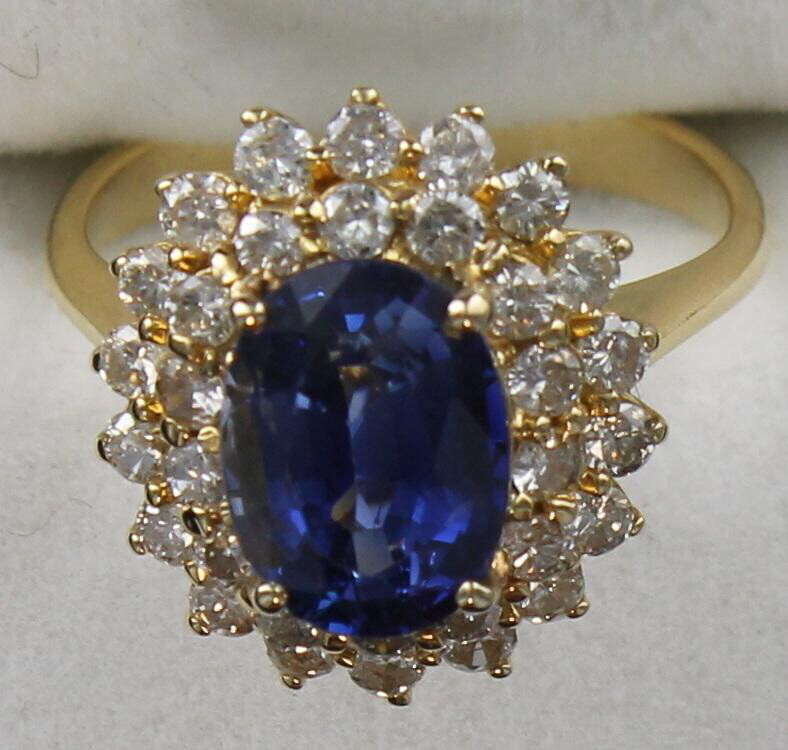 18KT SAPPHIRE AND DIAMOND RING