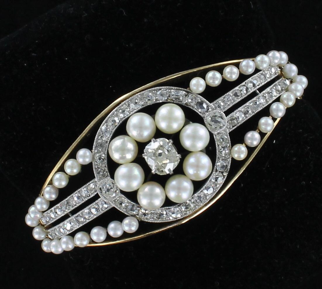 14KTY DIAMOND AND PEARL BRACELET CIRCA 1900