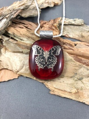 Gorgeous red pendant with a silver butterfly decal  on a silver necklace