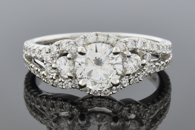 Three Stone Engagement Ring with Diamond Trim
