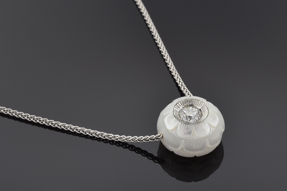 Carved pearl and diamond necklace by Galatea