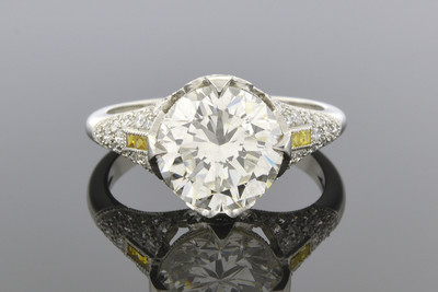 Engagement Ring with Yellow Diamond Trim