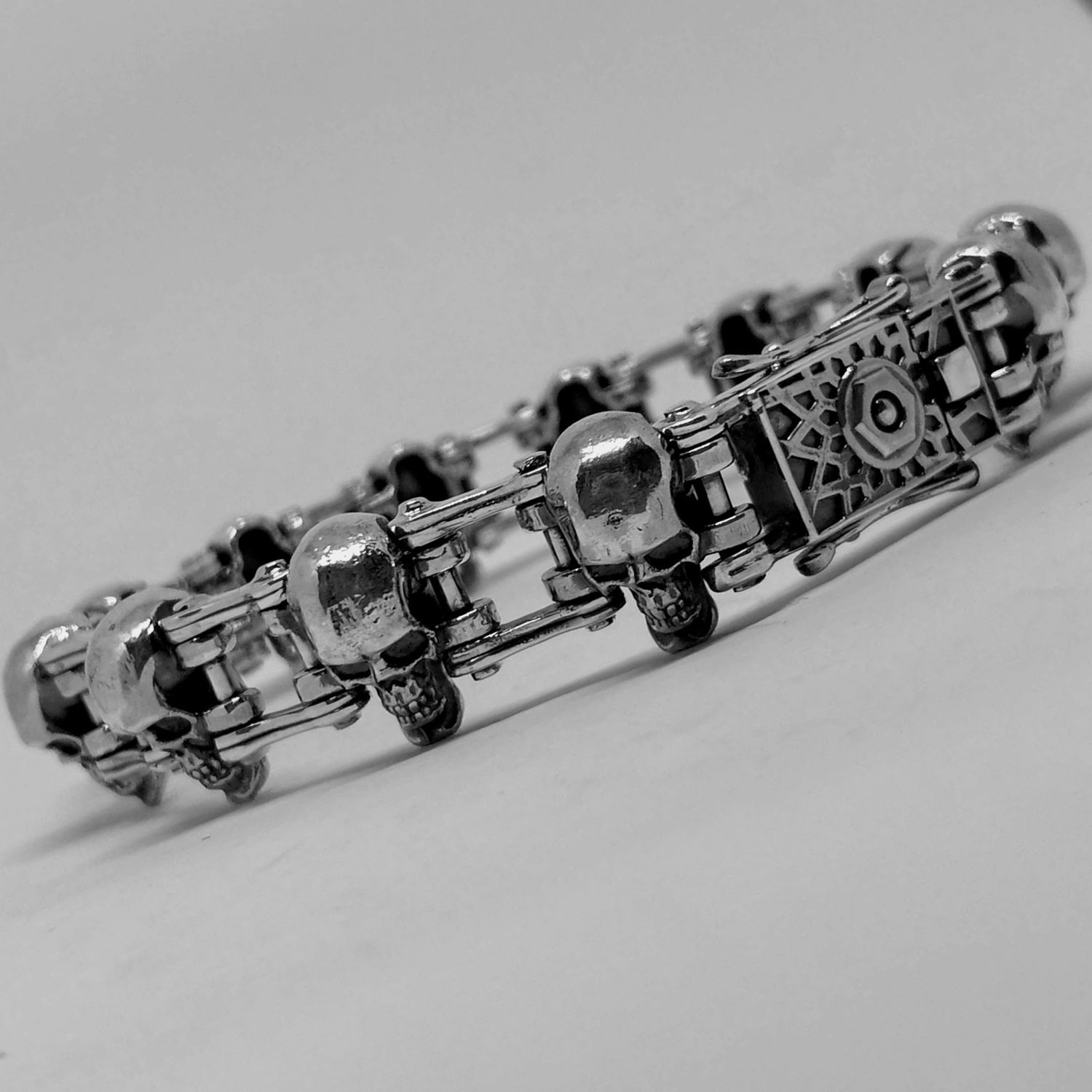 "Silver bracelet with skulls and chain's links ""Moto Bro"""