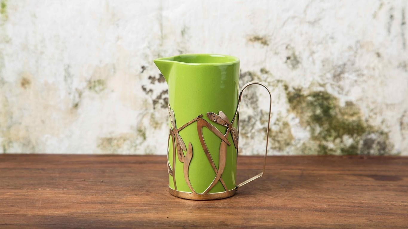 Milk jug with bronze holder