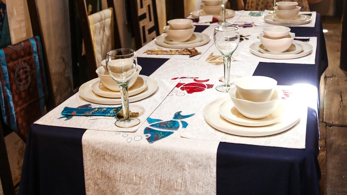 Reaching Out fish embroidered table runner