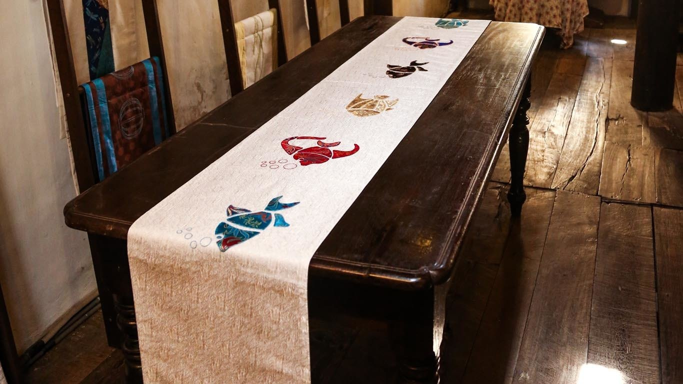 Reaching Out fish embroidered table runnerReaching Out fish embroidered table runner